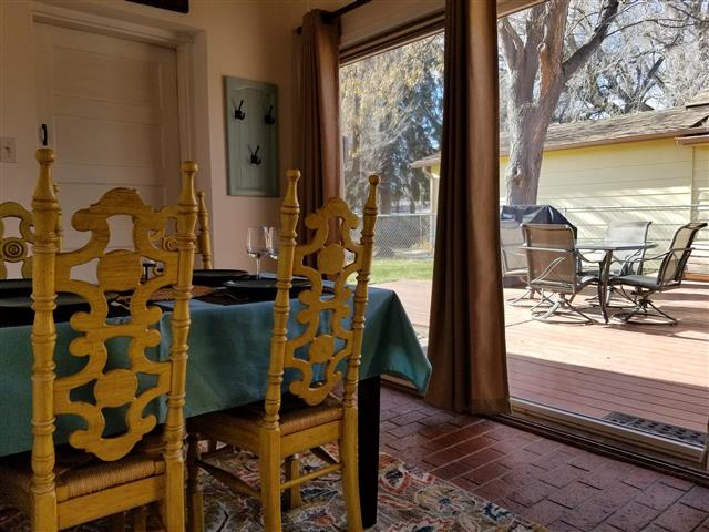 Photo of the dining area and the back deck of our house in Fort Collins Colorado