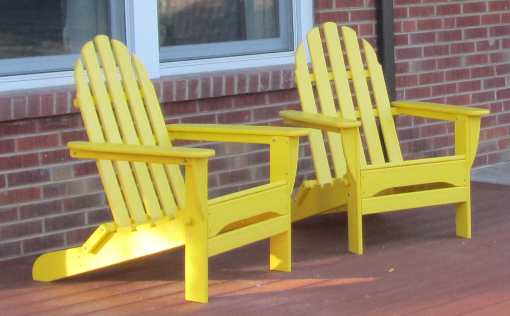 Yellow Adirondack chairs on the front deck